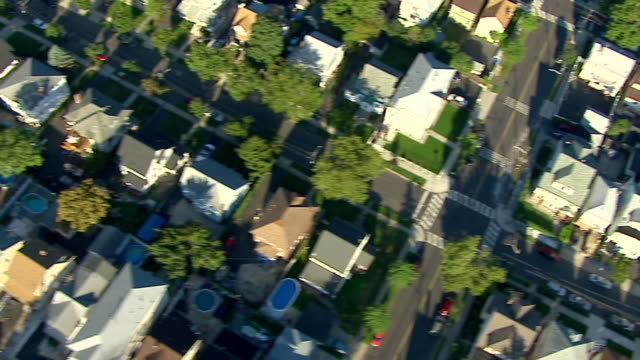 rows of houses fill a suburban neighborhood. - district stock videos & royalty-free footage
