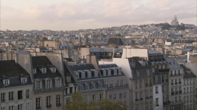 Rows of houses line the Sacre Coeur to the Eiffel Tower in Paris. Available in HD.