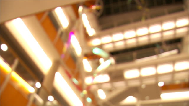 rows of lights shine from a multi-floor building. - fluorescent light stock videos & royalty-free footage