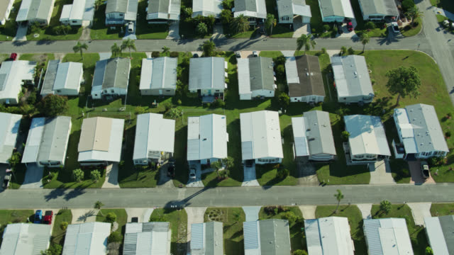 rows of manufactured homes in barefoot bay, florida - florida us state stock videos & royalty-free footage