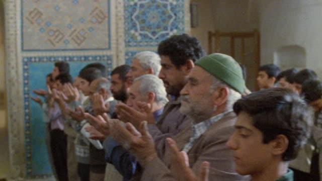 ms pan rows of men praying in jameh mosque (friday mosque) / yazd, iran - teenage boys stock videos & royalty-free footage