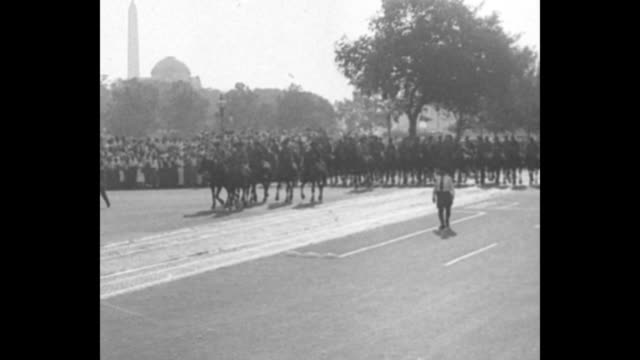 rows of mounted us military and tanks pass camera and the procession walks in direction of capitol hill / armed soldiers and police on street / men... - wwi tank stock videos & royalty-free footage