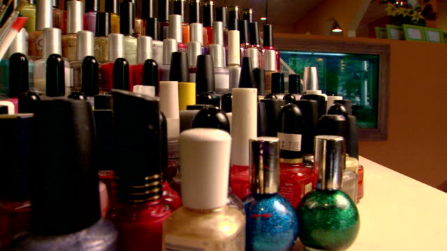 rows of nail polish and manicure tools - tidy stock videos & royalty-free footage