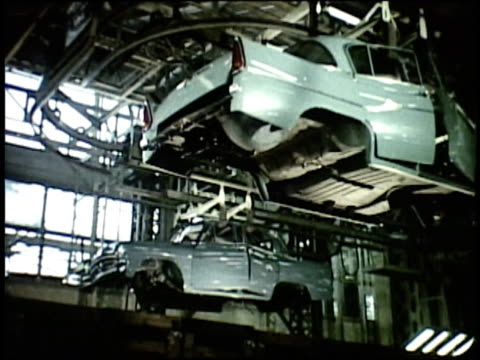 1963 montage rows of new cars stored in parking lot; cars on factory assembly line / japan - showa period stock videos & royalty-free footage