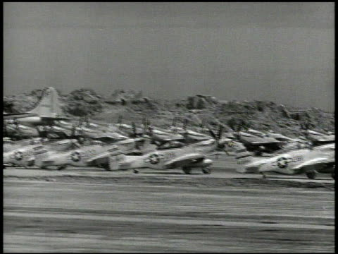 Rows of North American P51 Mustang fighter aircrafts on field at airbase including B29 Superfortress VS Mustangs taxiing amp taking off from runway...