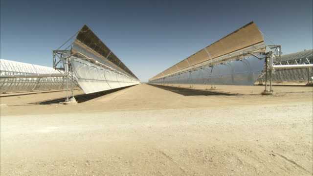 Rows of parabolic troughs collect solar energy outside Andasol solar power station. Available in HD