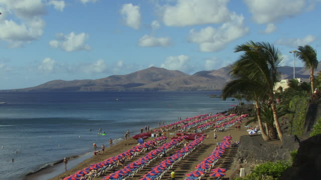 ws, ha, rows of parasols on playa grande, puerto del carmen, lanzarote, canary islands, spain - unknown gender stock videos & royalty-free footage