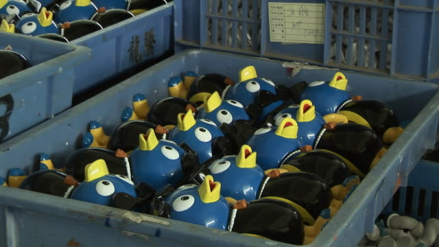 CU Rows of plastic duck toys in tray/ ZO WS Stacks of trays of toys in factory warehouse/ Dongguan, China