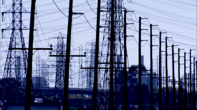 rows of power lines in silhouette available in hd. - telegraph pole stock videos and b-roll footage