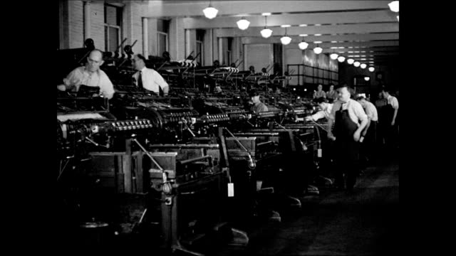 stockvideo's en b-roll-footage met rows of printing machines cu us soil conservation literature w/ illustrations coming off press folded booklets coming out of machine male hands... - 1937