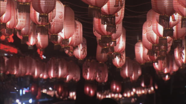 MS LA Rows of red lanterns hanging from ceiling in shopping district, Beijing, China