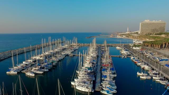rows of sailing boats moored at berth - moored stock videos & royalty-free footage