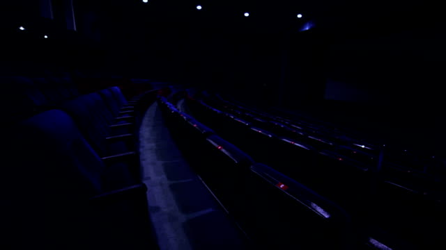 Rows of seats in empty blue cinema hall