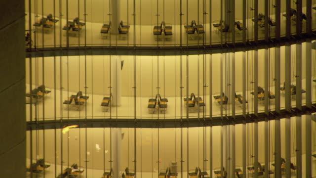 vídeos y material grabado en eventos de stock de rows of seats line the corridors of a modern office building. - transparente