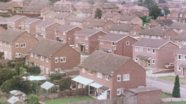 1980 montage rows of semi-detached houses in suburban development, and houses across the street through another's windows / united kingdom - 1980 stock videos & royalty-free footage