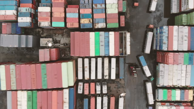 stockvideo's en b-roll-footage met rijen van het verschepen van containers in poort terminal - voor anker gaan