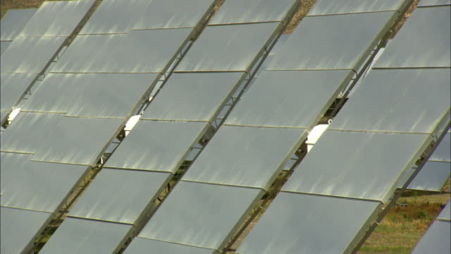 CU Rows of solar panels in desert at Plataforma Solar del Almaria, Almaria, Spain