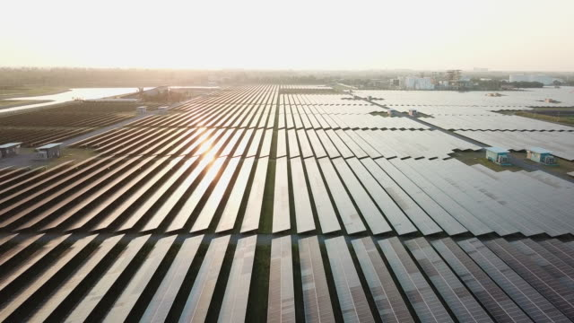 rows of solar panels in vast power station - generator stock videos & royalty-free footage