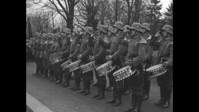 rows of soldiers goose-stepping past and drummers play in unison / the soldiers marching past paul von hindenburg at left; he shakes hands of... - dresden germany stock videos & royalty-free footage