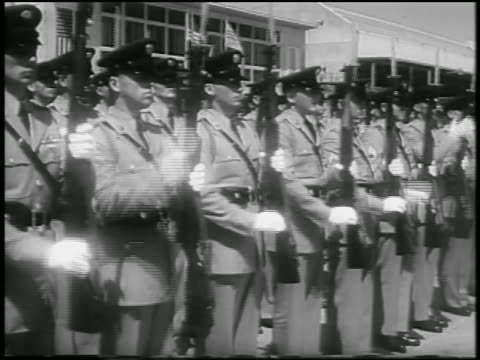 vídeos y material grabado en eventos de stock de b/w 1957 rows of soldiers in uniforms lift rifles in salute outdoors / washington dc - 1957