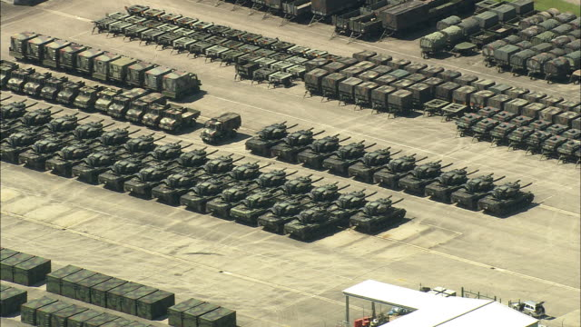 aerial rows of tanks and containers in military base, rhineland, germany - kampfpanzer stock-videos und b-roll-filmmaterial