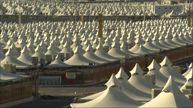 rows of tents comprise mina in mecca. - tent stock videos and b-roll footage