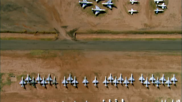 aerial, rows of un-used military aircrafts, davis-monthan air force base, tucson, arizona, usa - military base stock videos & royalty-free footage