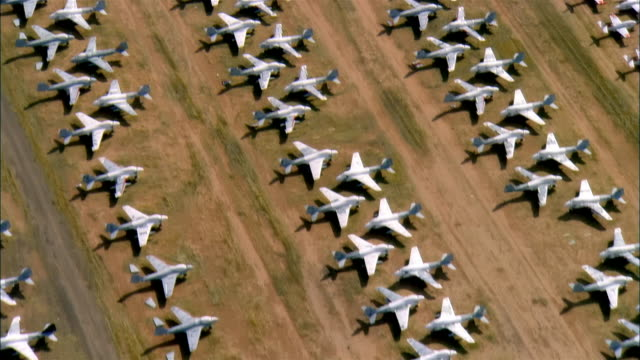 aerial, rows of un-used military aircrafts, davis-monthan air force base, tucson, arizona, usa - air force stock videos & royalty-free footage