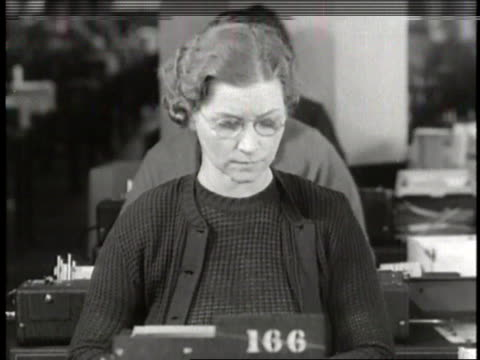 rows of women work on punch card machines at desks in a large social security office - punch card stock videos & royalty-free footage