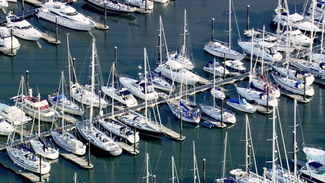 WS AERIAL POV  Rows of yachts moored in marina / Lymington, Hampshire, England