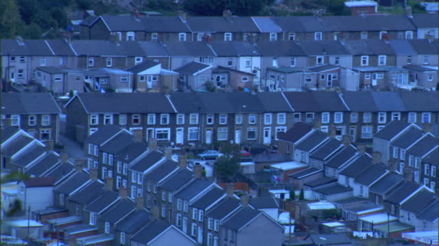 rows rows of similarly designed connected residential houses uk - terraced house stock videos & royalty-free footage
