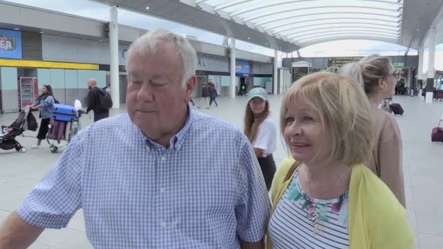 roy and jennie lloyd followed by geoff knipe and sue dockerill talk about their flight cancellation due to the collapse of british travel company... - collapsing stock videos and b-roll footage