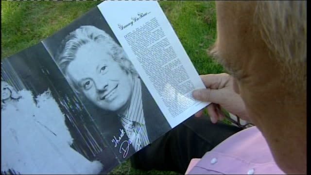 roy hudd looking at magazine with ohotographs of dsanny la rue roy hudd interview sot remembers danny la rue - roy hudd stock videos & royalty-free footage