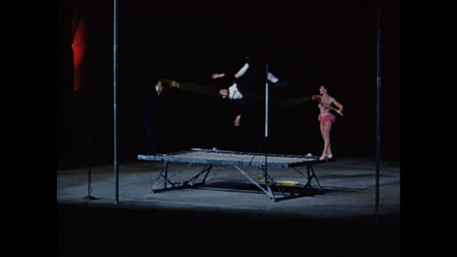 vídeos y material grabado en eventos de stock de roy rogers show acrobats on trampoline at canadian national exhibition night toronto ontario canada - mujer con grupo de hombres