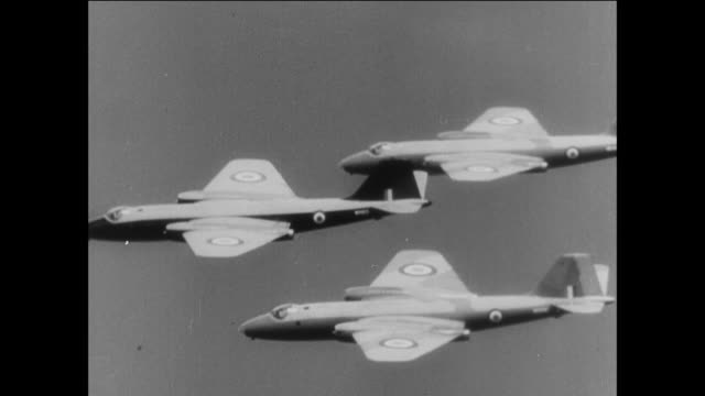 stockvideo's en b-roll-footage met royal air force aircraft soaring through the sky and military personnel readying planes / suez canal crisis 1950's - suezcrisis