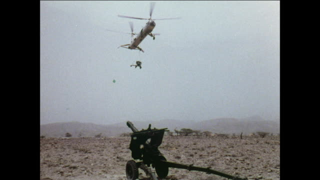 montage royal air force belvedere helicopter delivers an artillery piece on a hill / aden, yemen - yemen stock videos & royalty-free footage