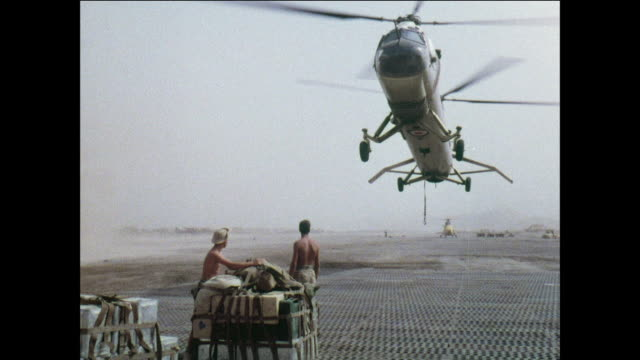 montage royal air force belvedere helicopter transports materials to soldiers in the mountains / aden, yemen - aden stock videos & royalty-free footage