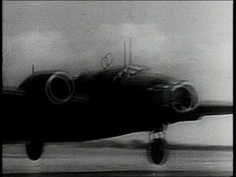 vídeos de stock, filmes e b-roll de royal air force bombers rotating / raf airplanes taking off - 1943