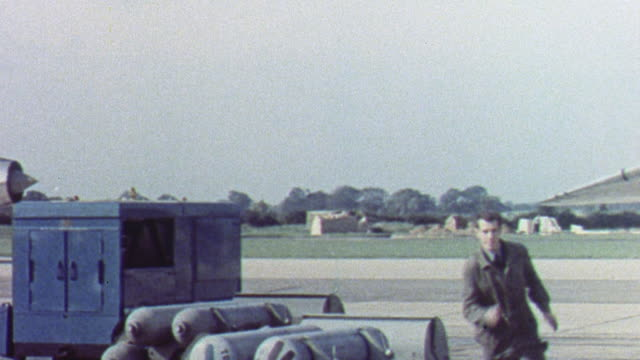 1962 montage royal air force crew loading missiles and fighter jets taking off / united kingdom - 冷戦点の映像素材/bロール
