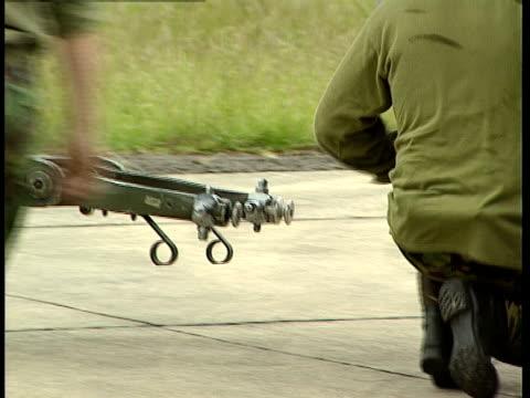 royal air force ground crews attach a tow boom to a harrier jet. - landefahrwerk stock-videos und b-roll-filmmaterial