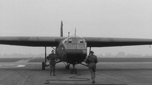montage royal air force launching operation varsity on march 24, 1945, with four-engine bombers towing gliders with parachute troops through take off and toward the rhine river / united kingdom - glider stock videos & royalty-free footage