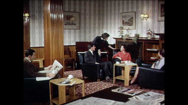 montage royal air force male and female members socializing at the officer's mess, working at a desk in a private room and dining with other officers / united kingdom - raf stock videos & royalty-free footage