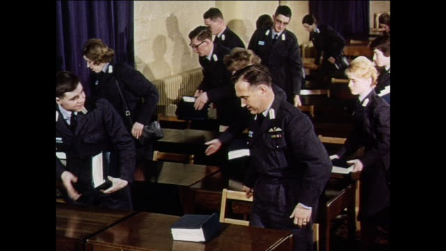montage royal air force members marching and participating in public relations training in a classroom/ united kingdom - military school stock videos and b-roll footage