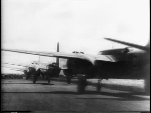 royal air force pilots fly 'boston bombers' along airfield and into sky / shot from below them flying in formation / aerial view of english... - anno 1942 video stock e b–roll