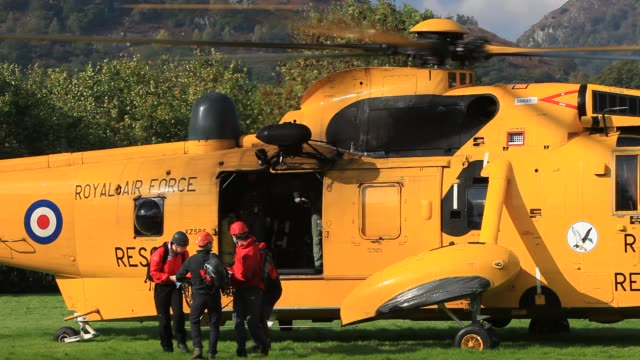 a royal air force sea king helicopter attending a mountain rescue incident in ambleside in the lake district uk - british military stock videos & royalty-free footage