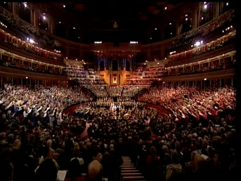 vídeos de stock, filmes e b-roll de royal albert hall reopens after 70 million pound makeover; lib performer on stage audience ext construction work next albert hall - royal albert hall