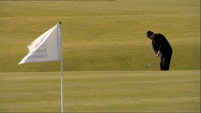 royal and ancient golf club to vote on allowing women members; scotland: fife: st andrews: ext various shots golfers on golf course tilt up royal and... - sportlerin stock-videos und b-roll-filmmaterial