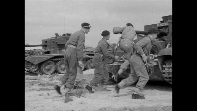 vídeos de stock, filmes e b-roll de montage royal armoured corps soldiers entering a naafi restaurant and boarding a tank and training on a beach with other tanks / tripoli, libya - líbia