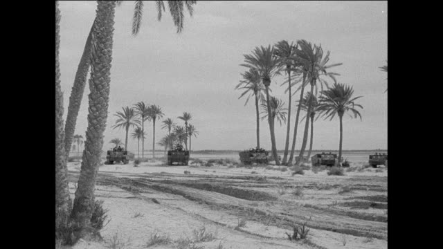 stockvideo's en b-roll-footage met montage royal armoured corps soldiers riding in tanks while participating in a training exercise and disembarking on the beach / tripoli, libya - libië