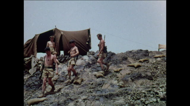 montage royal army soldiers place an artillery piece on a hill / aden, yemen - yemen stock videos and b-roll footage